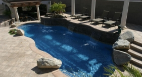Freeform Swimming Pool with Deck Jets, Pergola and Sheer Descent