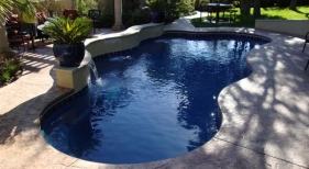 Freeform Swimming Pool with Pergola and Sheer Descent
